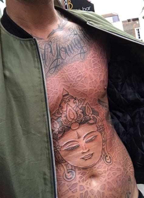 calum    torso tattoo daily star