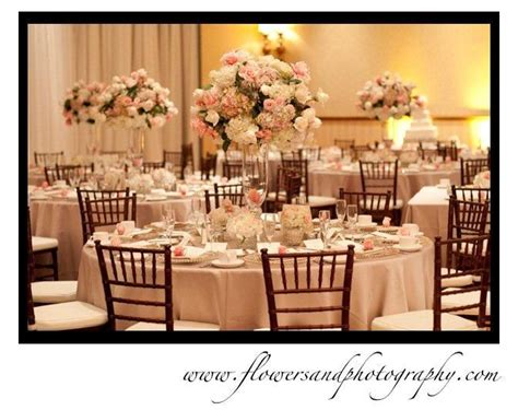 reception tables blush pink and white center pieces