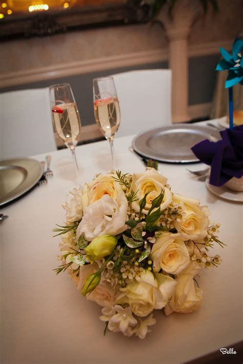 The bride's bouquet sits on the bride & groom table at the