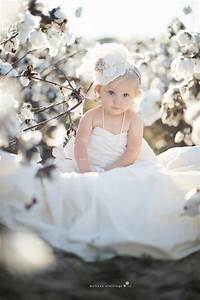 baby in moms wedding dress eastern nc photographer With baby wedding dress