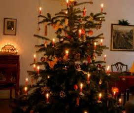 two candlelit christmas trees the unbroken threadthe unbroken thread