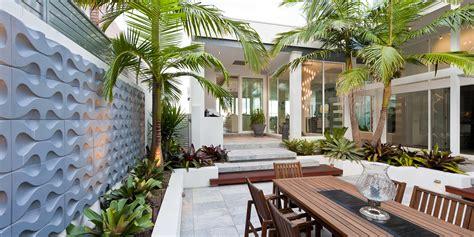 stunning sunken courtyard design  coastal oasis