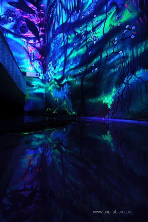 artist paints rooms  murals  glow  blacklight