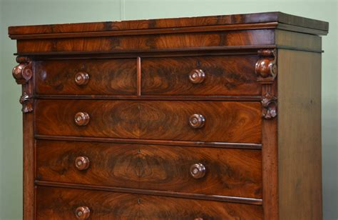 Comprising 2 short drawers over 3 long drawers it has black and red stringing decoration painted onto the top and fronts of the drawers along with black ceramic handles, and. Large Victorian Figured Mahogany Antique Scottish Chest Of ...