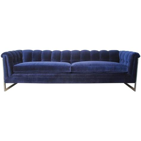 blue mid century modern sofa blue velvet tufted back chrome frame mid century modern