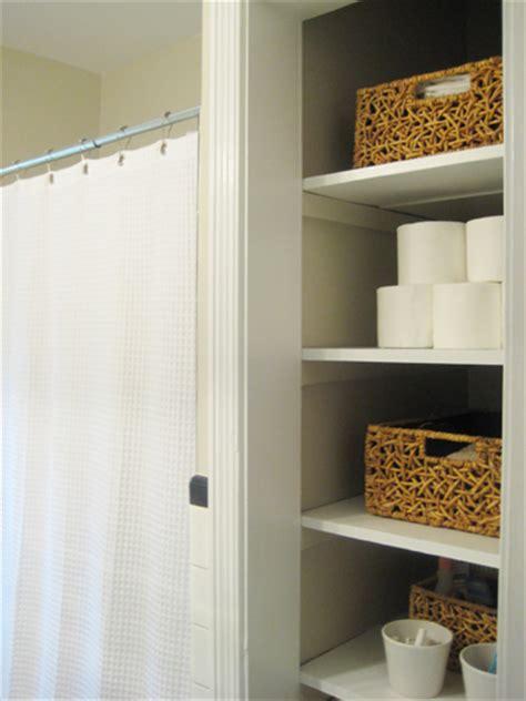 door   bathroom linen closet   chic  open feeling