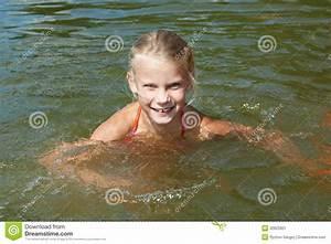 Little Girl Swimming In Lake Stock Image - Image: 32623901
