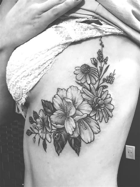 gladiolus flower tattoo black  white rib tattoo
