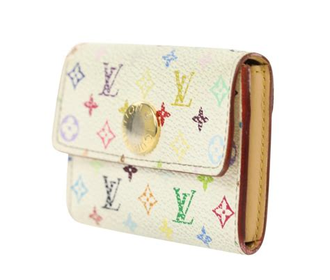 It opens to reveal a large compartment for cards and two discreet storage spaces. Louis Vuitton White Multicolore Monogram Business Card Holder Wallet - Tradesy