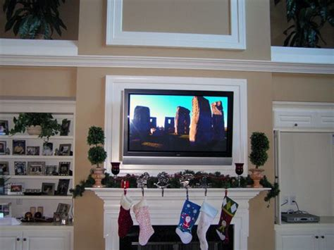 tv above fireplace where to put components 37 best images about tv fireplace on mantels