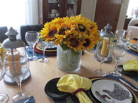 welcomed guest chickens  sunflowers tablescape