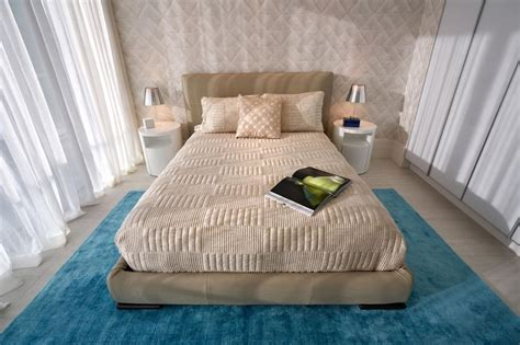 Neutral Contemporary Bedroom With Blue Rug