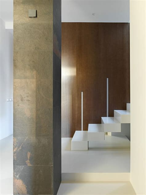 Invisible Doors Turn A Modern Home Into An Artistic Feat Of Design invisible doors turn a home into an artistic feat of design