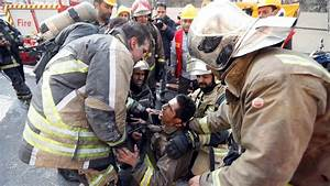 Tehran: 'More than 20 firefighters dead' in Iran building ...
