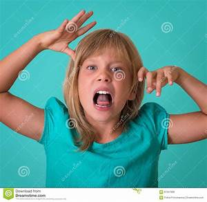 Angry Little Girl Growls Isolated On Turquoise Background ...