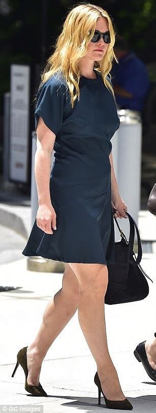Julia Stiles Flashes Some Leg In Navy Sheath At Presser