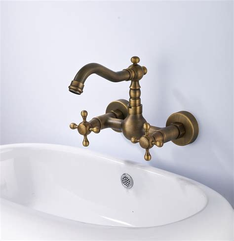 Double Handle Wall Mount Kitchen Faucet In Antique Brass
