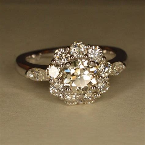 art deco inspired flower shaped engagement ring 14k and 18k white gold engagement wedding