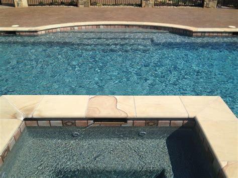 gorgeous blue granite pebble sheen pool mediterranean