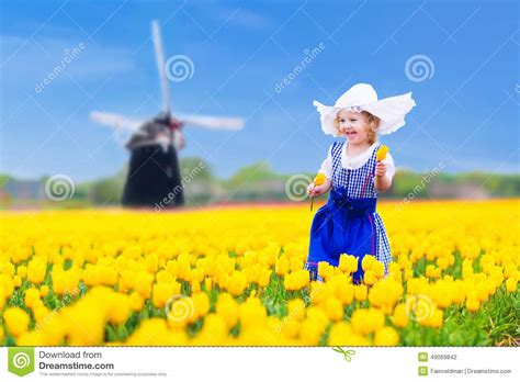 dutch girl  tulip field  holland stock photo image