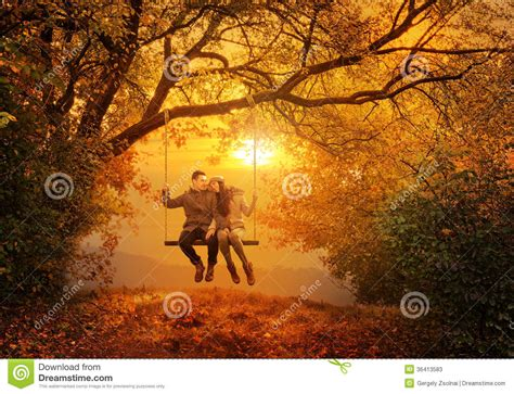 couples swing swing in the autumn park stock photos