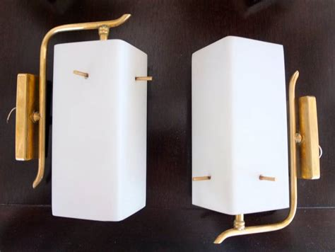 pair of 1950s brass sconces with box shaped white glass shades for sale at 1stdibs