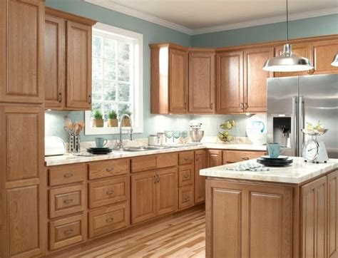 kitchen remodel with oak cabinets and gray wall paint