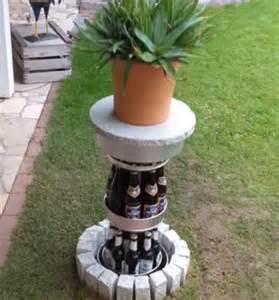wine and beverage cooler garden ornament rises out of lawn to reveal