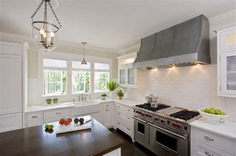 white kitchen with custom inset rutt cabinets and zinc