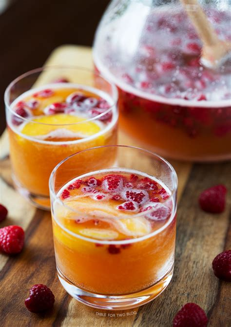 prosecco peach punch raspberry drink recipe cocktails recipes table tablefortwoblog sparkling cocktail party dishmaps fruit enthusiasts amazing drinks christo generous