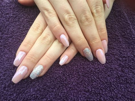 In order to keep up with winter trends ballerina's nails are essentially the stiletto nail, but with a square rather than the pointy tip. Coffin nails. Acrylic. Glitter. Pink. Mermaid powder. Ibd ...