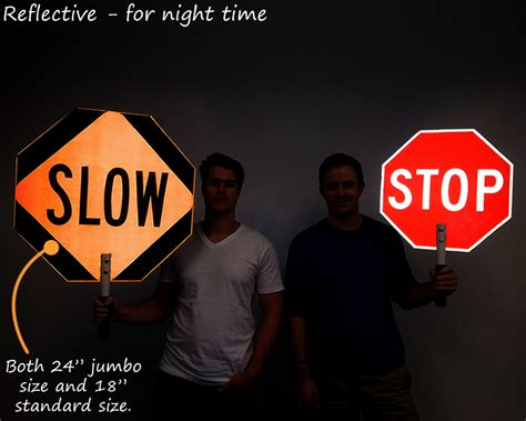 stop slow signs held held stop sign paddles