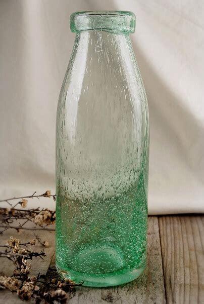 flourish vintage hand blown bottle