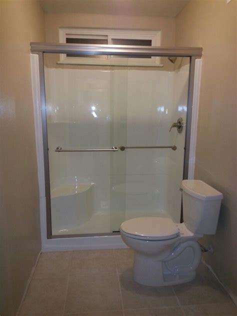 New Shower Door by Don T Replace That Fiberglass Shower Stall Reglaze It