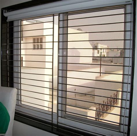 awning windows  grilles google search burglar bars stone accent walls flat roof house