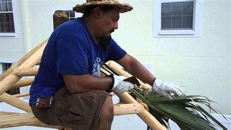 Freddys Tiki Hut - freddy putting palms on tiki hut