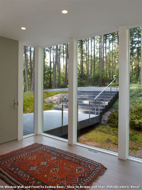 Red Area Rugs with Modern Entry and Deck Floor to Ceiling Windows Tall Door Recessed Lighting