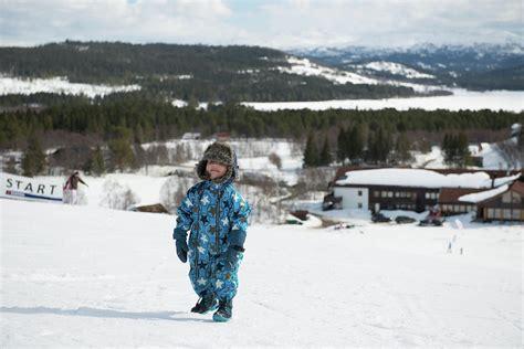 Boy Child Kid Walking Playing In Snowy Mountain In Winter