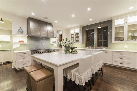 kitchen island with stove and seating pleated bar stools transitional kitchen