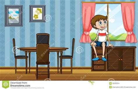 A Boy Sitting Above The Cabinet Near The Window Stock