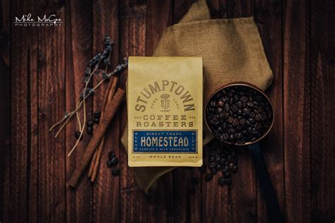 Add coffee grounds into a container. Stumptown Coffee Product Photography Shoot - Mike McGee Photography