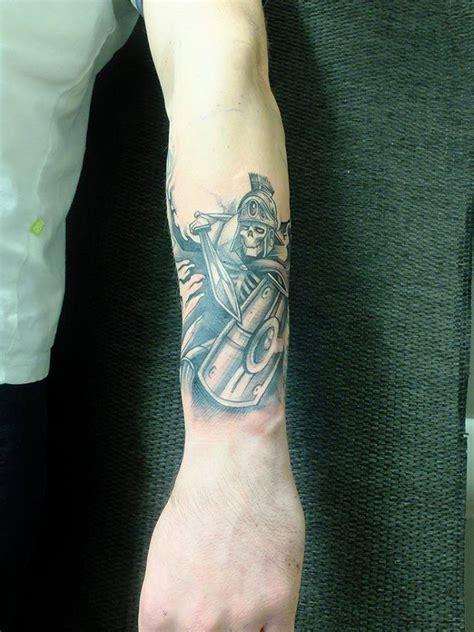 black  red warrior tattoo   arm
