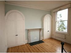 Bespoke Arched Wardrobes purpose built to fit into