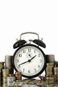 Time Is Money Concept  Alarm Clock And Lots Of Euro Coins