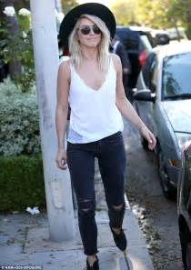 Julianne Hough smiles as she narrowly avoids wardrobe ...