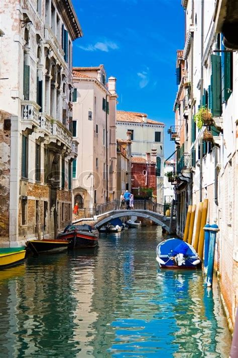 Green And Blue Water Of A Typical Venetian Canal Italy