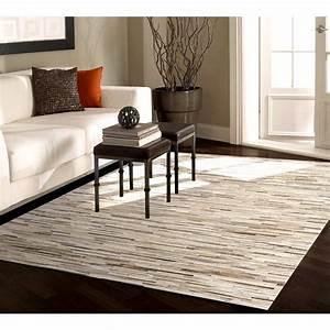 Tapis cuir shahrukh beige 200x300 cm retrouvez nos tapis for Tapis design avec canape cuir perpignan
