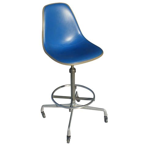 eames fiberglass shell chairs with painted backs or two