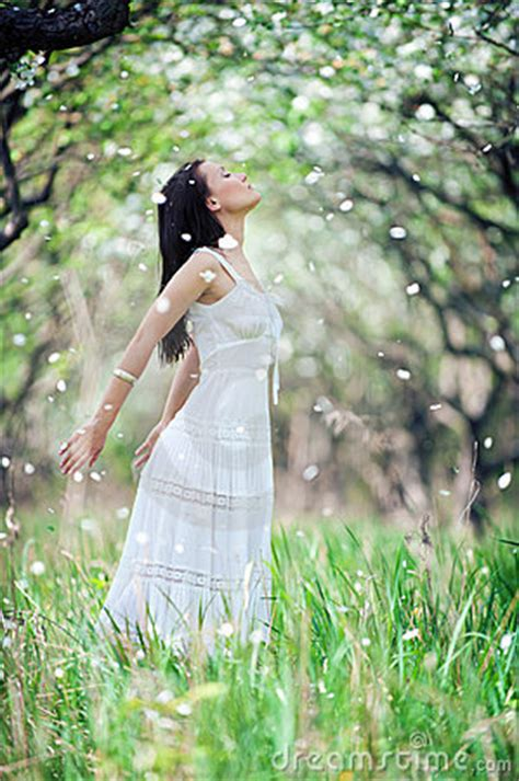 carefree young woman  white dress stock photography