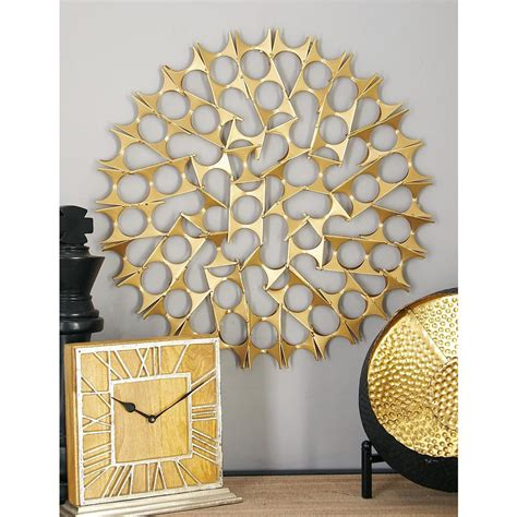 Each piece of artwork is mounted on a wooden frame and layered over hardboard with a brown wash and nailhead accents. Litton Lane Tin Gold Bowties Orb Metal Wall Decor (Set of ...